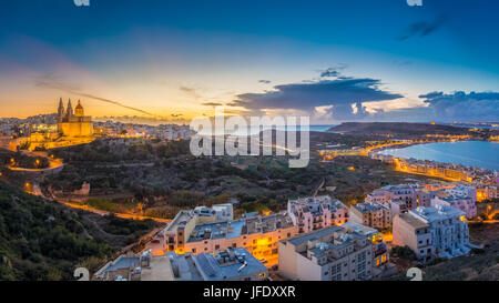 Il-Mellieha, Malta - Beautiful panoramic skyline view of Mellieha town at blue hour with Paris Church and Mellieha - Stock Photo