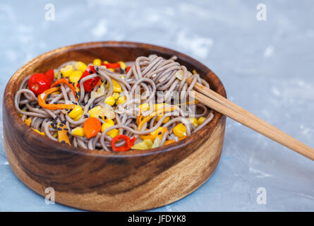 Buckwheat soba noodles with vegetables. Love for a healthy vegan food concept. - Stock Photo