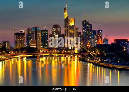Frankfurt skyscrapers reflected on Main River at twilight, Germany - Stock Photo
