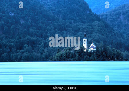 Church of the Assumption Island seen at the blue hour on Lake Bled, Slovenia - Stock Photo