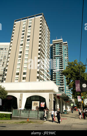Downtown apartment blocks in Vancouver West End Robson Street shopping area.  Vancouver BC, Canada. - Stock Photo