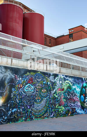 Colourful wall graffiti outside working factory in Tampere Finland - Stock Photo