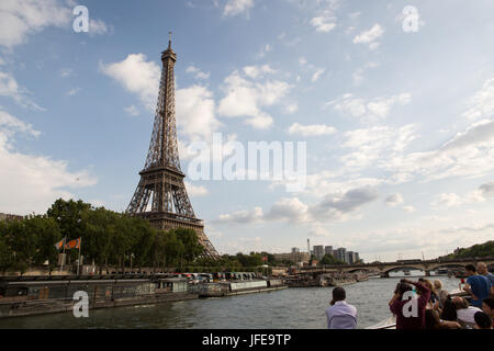 A view of the Eiffel Tower from a Seine River boat cruise. - Stock Photo