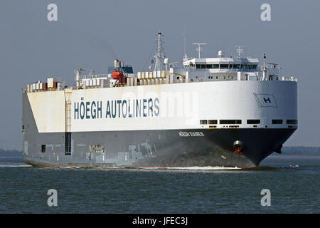 The car carrier Hoegh Xiamen passes Terneuzen and continues to the port of Antwerp. - Stock Photo