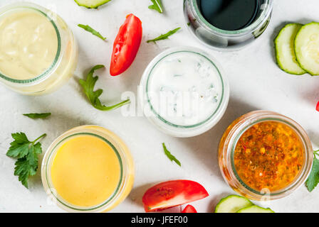 Set of dressings for salad: sauce vinaigrette, mustard, mayonnaise or ranch, balsamic or soy, basil with yogurt. - Stock Photo