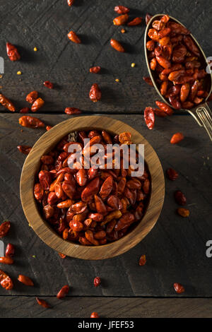 Organic Dry Small Pequin Chili Peppers in a Bowl - Stock Photo