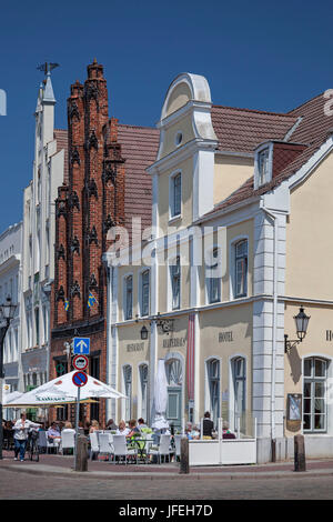 Old boy and Reuterhaus on the marketplace, Hanseatic town Wismar, Mecklenburg, Mecklenburg-West Pomerania, Germany - Stock Photo