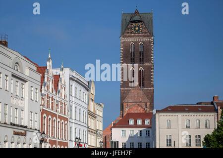 Marien's steeple behind houses on the marketplace, Hanseatic town Wismar, Mecklenburg, Mecklenburg-West Pomerania, - Stock Photo