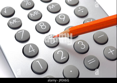 Red pen on electronic calculator - Stock Photo