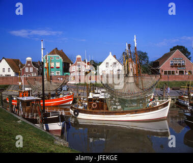 Crab cutters in the harbour of Greetsiel, East Friesland, North Germany, Germany - Stock Photo