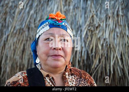 Chile, Araucania, Llaguepulli, Mapuche, Ruka, round house, woman, traditional costume, - Stock Photo