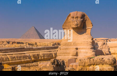 Sphinx and pyramids at Giza, Cairo - Stock Photo