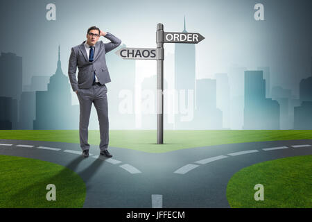 Businessman in difficult choice concept - Stock Photo