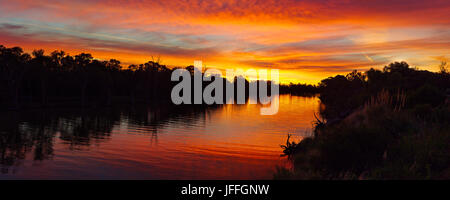 Typical Summer sunset over the Murray River at Gol Gol, NSW, Australia. - Stock Photo