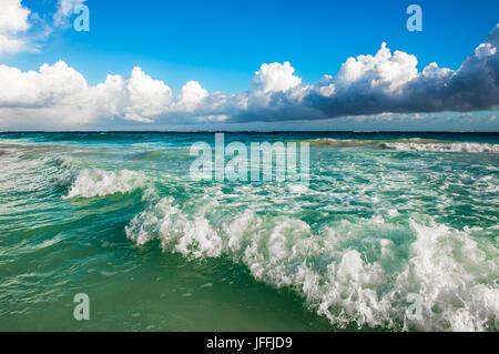 Waves crashing on the beach - Stock Photo
