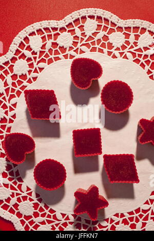 Red marmalade in molds on white napkin - Stock Photo