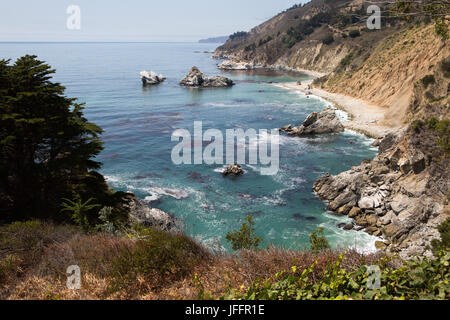 A view of the Pacific Ocean and beaches from the rocky Big Sur coast. - Stock Photo