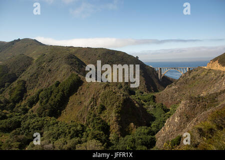 A scenic view of the Bixby Creek Bridge, a concrete, open-spandrel arch bridge, on the Pacific Coast Highway, and - Stock Photo