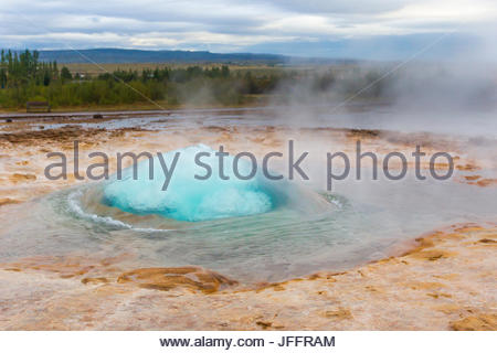 The Strokkur fountain geyser in the Haukadalur geothermal area. - Stock Photo