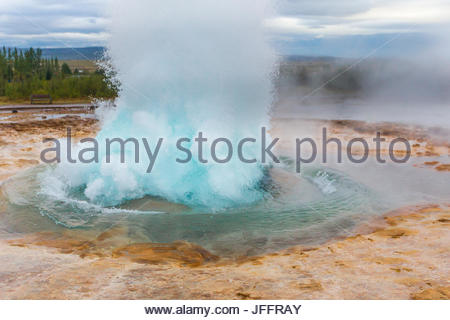 The Strokkur fountain geyser erupting in the Haukadalur geothermal area. - Stock Photo