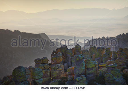 Vista west from Massai Point at sunset in Chiricahua National Monument. - Stock Photo