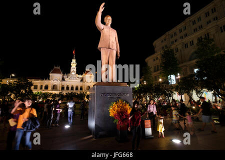 Statue of communist leader Ho Chi Minh in front of the City Hall building, Ho Chi Minh City, Vietnam, Asia - Stock Photo