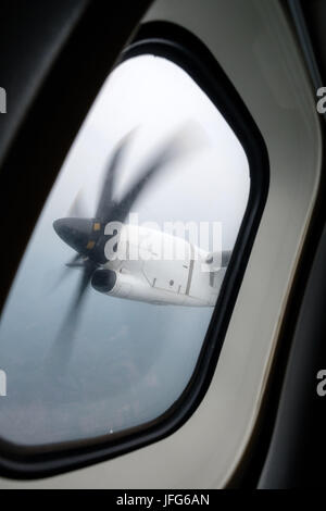 Window view of an engine propeller airplane viewed from inside the aircraft - Stock Photo