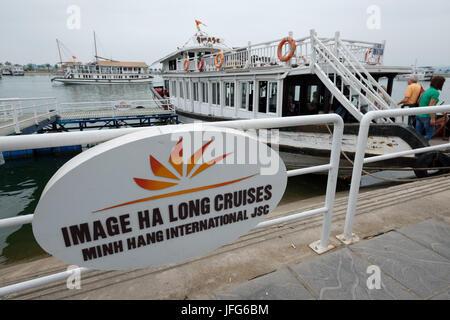 Passengers boarding a tour boat at Ha Long Bay harbor, Vietnam, Asia - Stock Photo