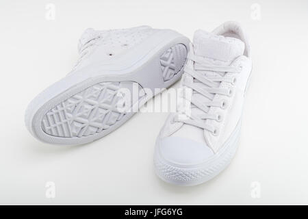 Pair of white Converse Chuck Taylor All Star shoes - Stock Photo