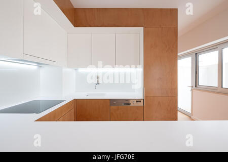 Modern kitchen interior with white and wood cabinets - Stock Photo