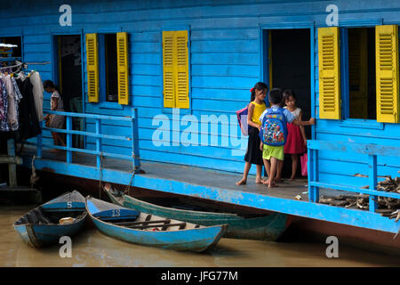 Kids waiting for classes to begin at a floating school on the Mekong river in Cambodia, Southeast Asia - Stock Photo