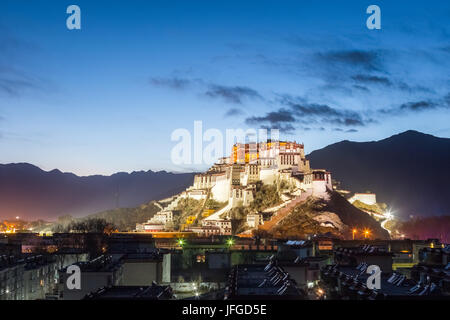 overlook of the potala palace in nightfall - Stock Photo