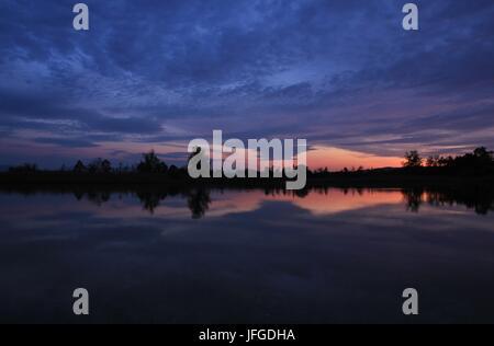 Sunset view from Ausslikon, lake Pfaffikon - Stock Photo
