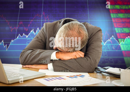 Composite image of tired businessman resting on desk - Stock Photo