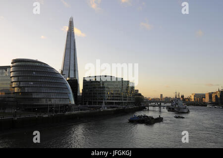 View from Tower Bridge along the River Thames with City Hall and The Shard on left and HMS Belfast and City of London - Stock Photo