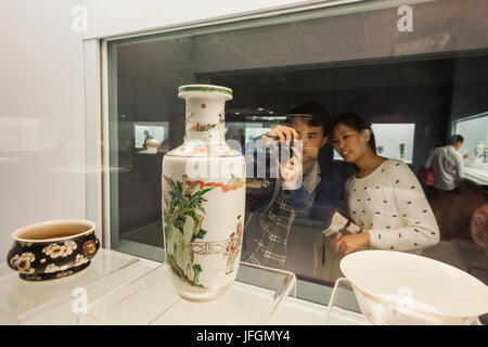 China, Shanghai, Shanghai Museum, Couple Looking at Ancient Pottery Display - Stock Photo