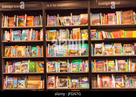 England, Bookshop display of Travel Guide Books - Stock Photo