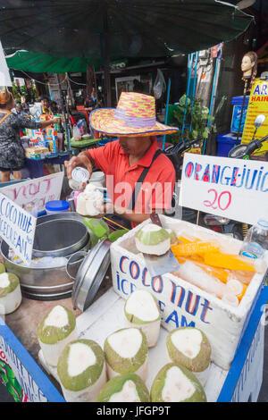 Thailand, Bangkok, Khaosan Road, Coconut Ice Cream Vendor - Stock Photo