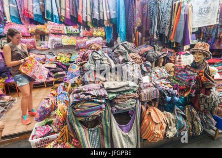 Thailand, Bangkok, Khaosan Road, Female Tourist Shopping in Street Stall - Stock Photo