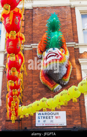England, London, Soho, Chinatown, Wardour Street, Chinese Lion on Building Facade - Stock Photo