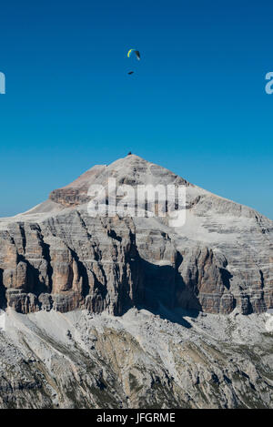 Paraglider about Piz gust, dolomites, aerial picture, high mountains, Trentino, Italy - Stock Photo