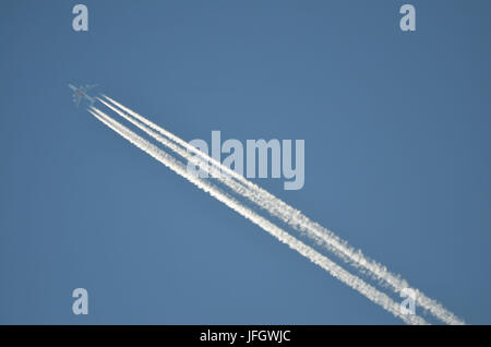 Civil aviation, air liner, heaven, condensation trail - Stock Photo