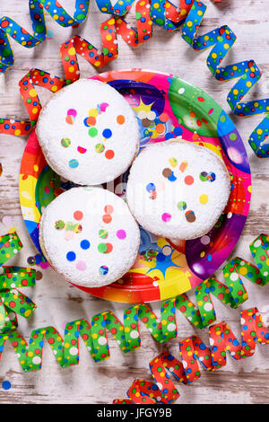 Carnival doughnuts to carnival with streamers - Stock Photo