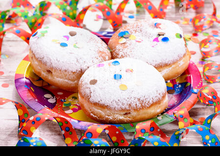 Carnival doughnuts to the carnival with streamers and confetti - Stock Photo
