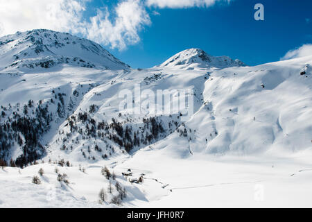 Winter scenery in the Simplonpass with old mountain hut, Valais, Switzerland - Stock Photo