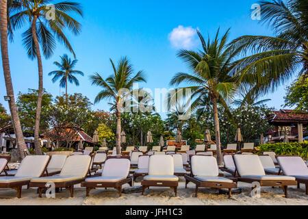 Deck chairs on the beach wait for tourist, Chaweng Beach, island Ko Samui, Thailand, Asia - Stock Photo