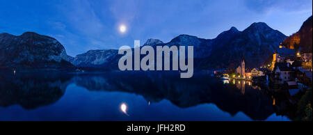 City centre at the Hallstätter lake in front of the Dachsteingebirge with full moon, Austria, Upper Austria, Salzkammergut, - Stock Photo