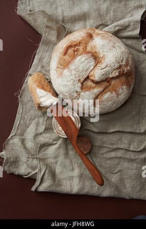 Fresh bread on vintage cloth - Stock Photo