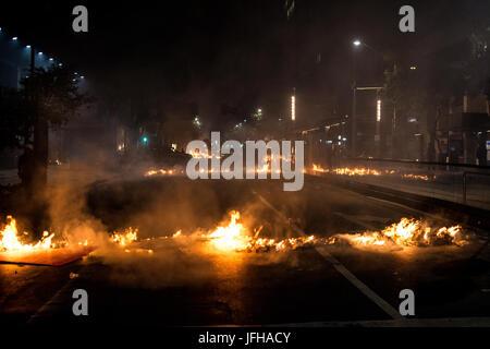 Rio de Janeiro, Brazil. 30th June, 2017. Anti-Government protesters start several fires throughout down-town Rio - Stock Photo