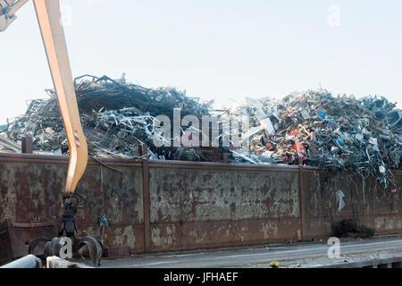 Heap of scrap metal for recycling at scrap yard - Stock Photo